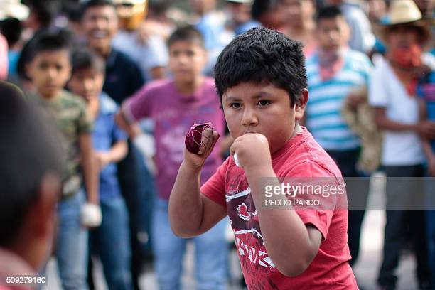 Two children engage in fisticuffs a facet of the Xochimilcas fight to defend their women against the Aztecs in the Mexican municipality of Zitlala in...