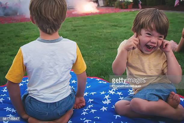 Two children enjoying fireworks display