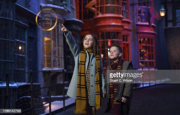 Two children explore a snowy Diagon Alley at the Warner Bros. Studio Tour London, as the festive Hogwarts in the Snow feature returns on December 01,...