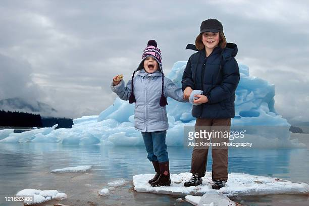 two children floating on ice flow - drift ice stock pictures, royalty-free photos & images