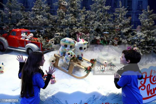 Two children gaze into Hamleys 2019 Christmas window display The oldest toy shop in the world has partnered with plush toy retailer Ty and the cast...