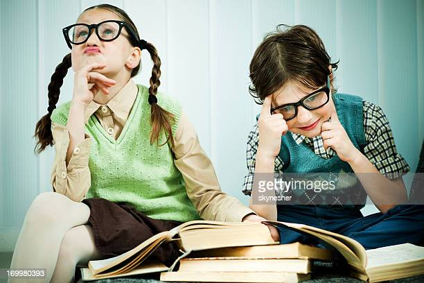 two children geeks thinking. - girl mound stock pictures, royalty-free photos & images