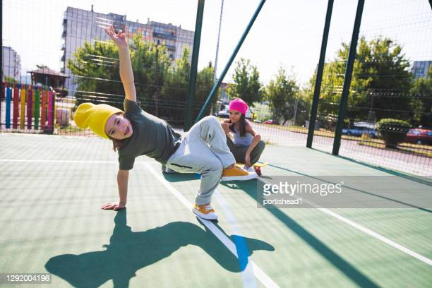 two children having fun and dancing on a playground - hip hop music stock pictures, royalty-free photos & images