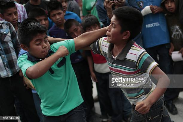 Two children hit each other in a fight representing the Xochimilcas fight to defend their women against the Aztecs in the Mexican municipality of...