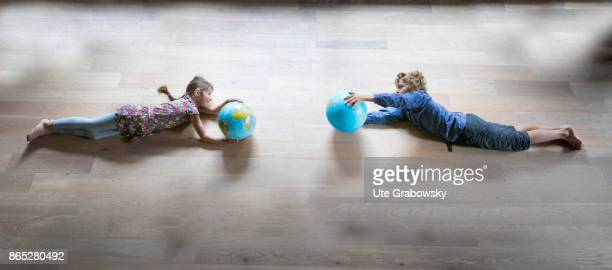 Two children hold a globe in their hands and fly towards each other on August 08 2017 in Sankt Augustin Germany
