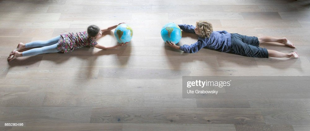 Flying children with globes : News Photo
