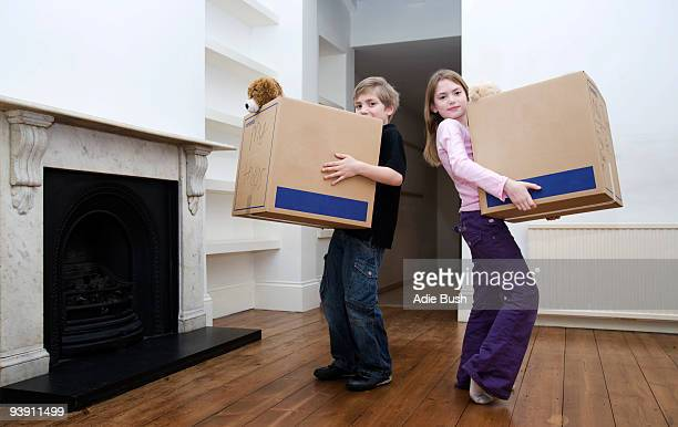 Two children holding boxes
