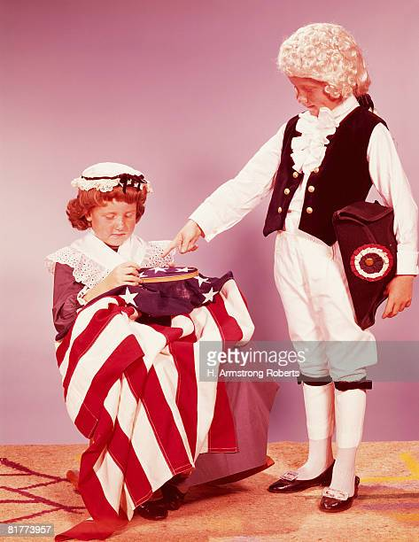 Two children in colonial costumes. (Photo by H. Armstrong Roberts/Retrofile/Getty Images)