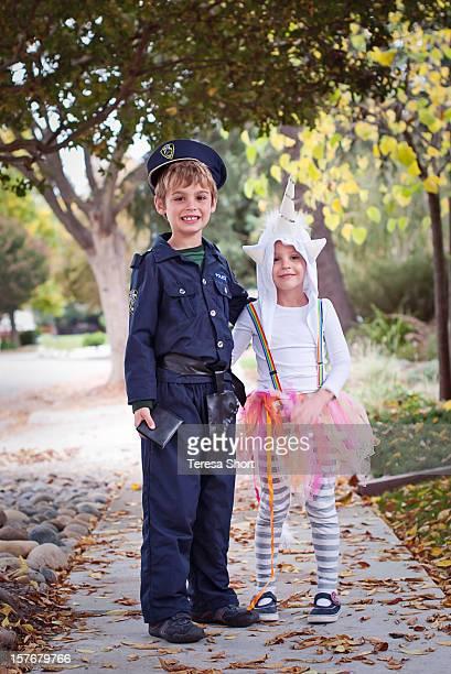 Two Children in Halloween Costumes