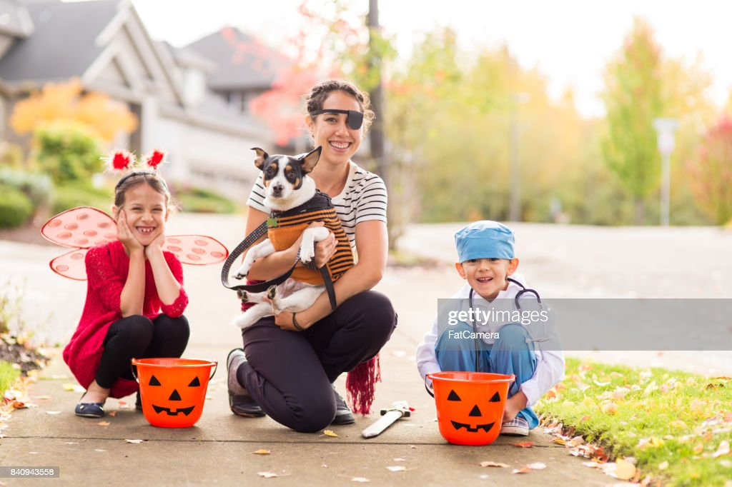 Two Children in Halloween Costumes Trick or Treating : Stock Photo