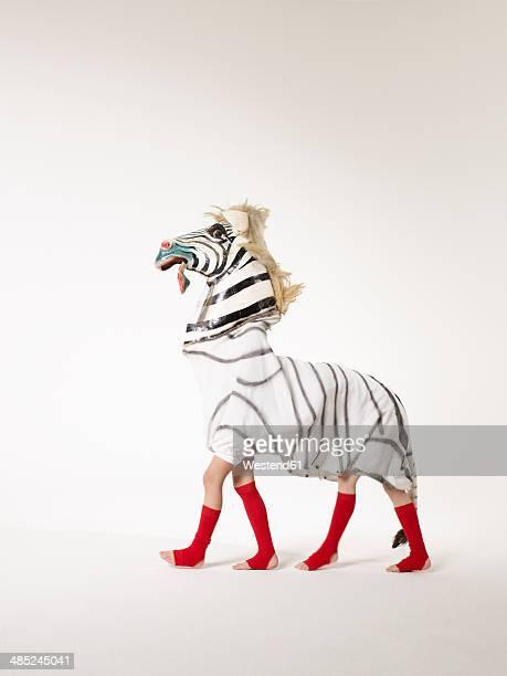 Two children inside zebra costume