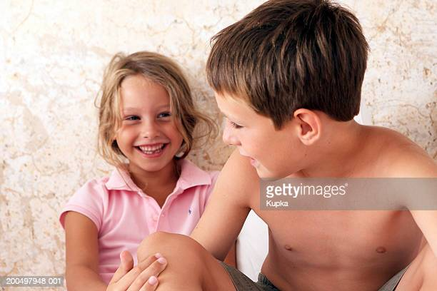 Two children (6-8) laughing