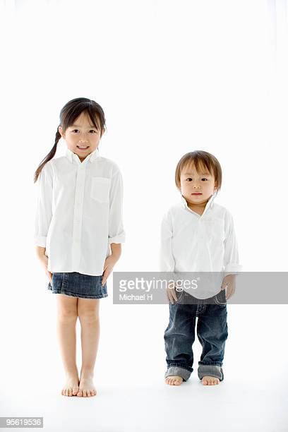 Two children line up and it stands