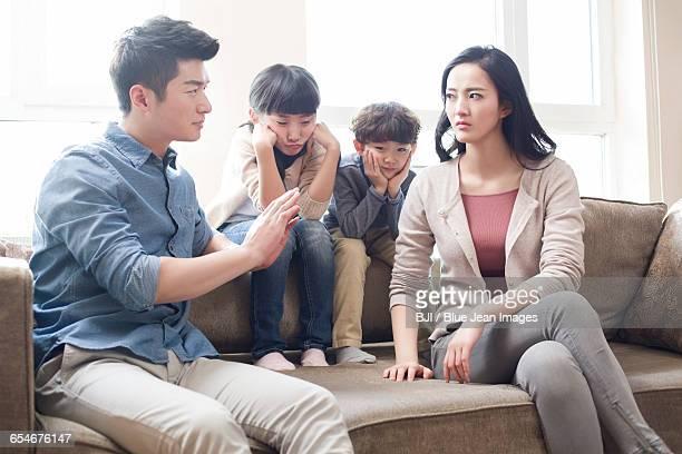two children listening to their parents arguing - stay at home father stock-fotos und bilder