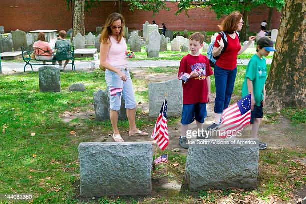 Two children look at Revolutionary Graves in Christ Church Burial Ground in Philadelphia Pennsylvania