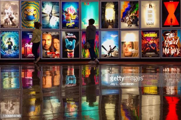 CA MARCH 12 2020 Two children looks at movie posters inside the lobby of the Arclight movie theater In Manhattan Beach Ca March 122020 The industry...