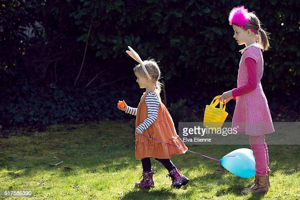 Two children on Easter egg hunt