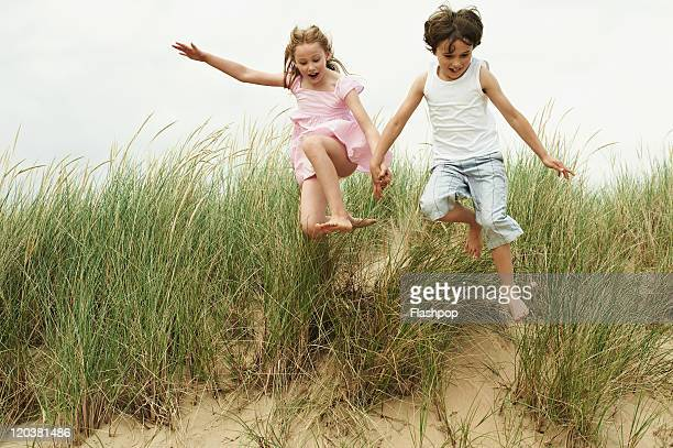two children playing at the beach - children only stock pictures, royalty-free photos & images