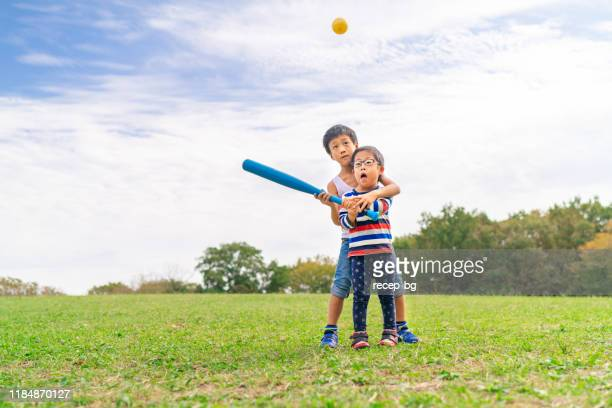 two children playing baseball - disabilitycollection stock pictures, royalty-free photos & images