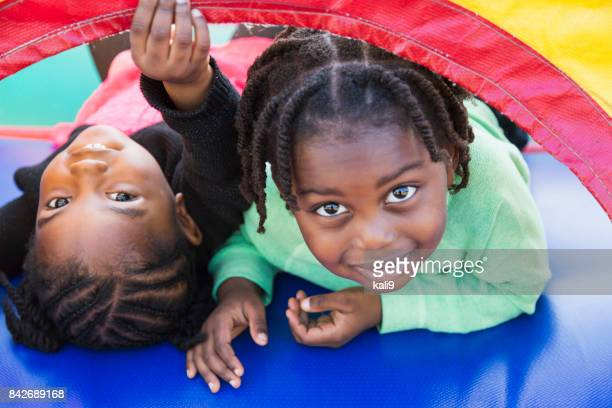 Two children playing in bounce house