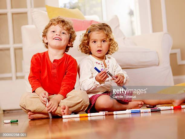Two children playing in living room