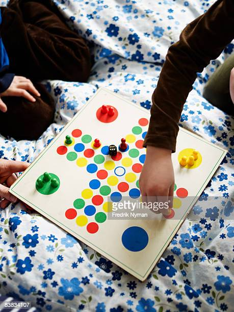 Two children playing ludo Sweden.