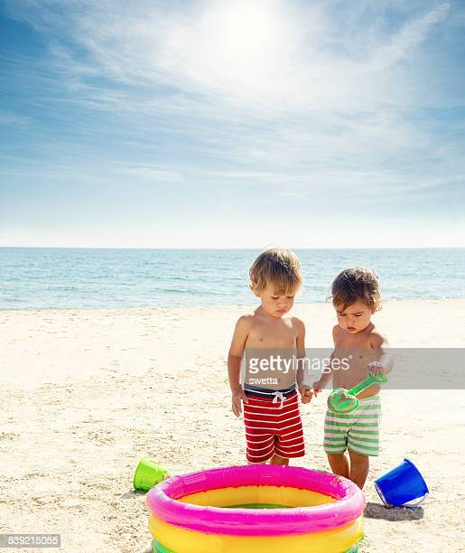Two children playing on the beach