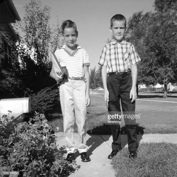 two children ready for school 1959, retro - 1950 1959 stock photos and pictures