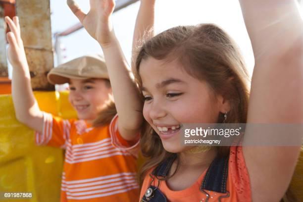 Two Children Ride a Ferris Wheel