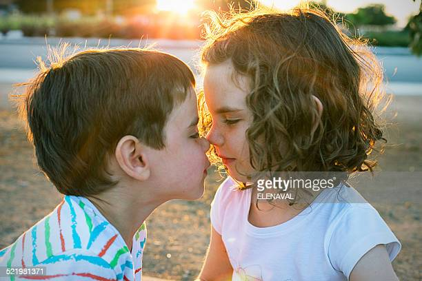 Two children rubbing noses