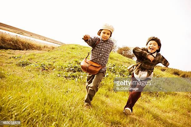 Two Children Running In The Prairie