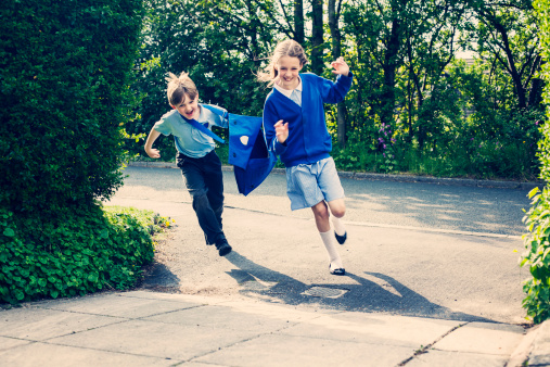 Two children running to home from school. - gettyimageskorea