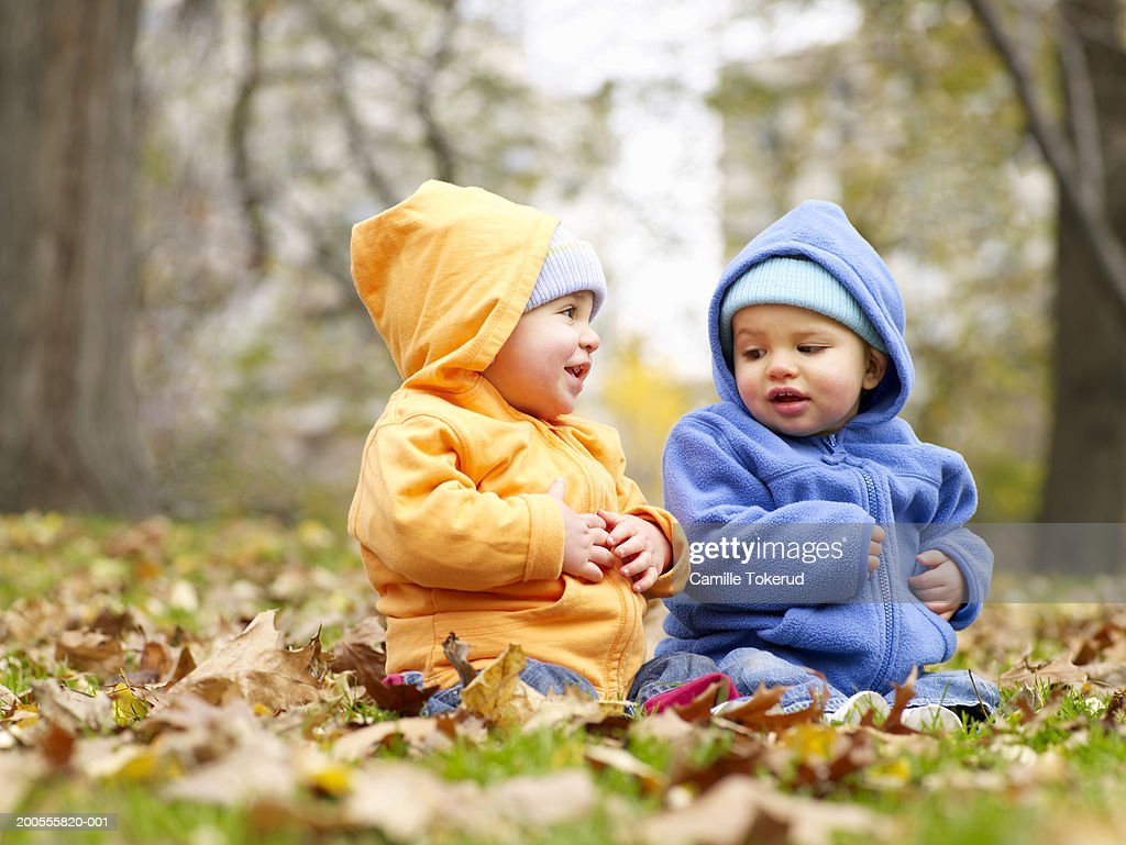 Two Children Standing On Dock High-Res Stock Photo - Getty