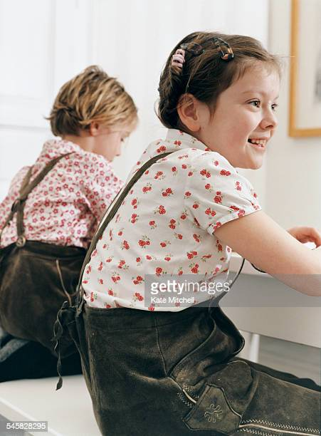 Two children sitting at table