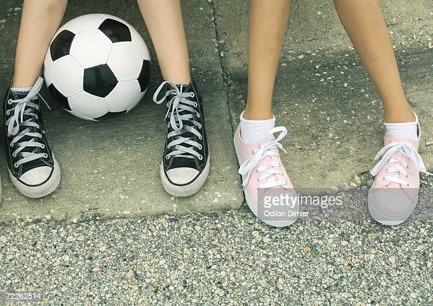 two children sitting on curb, view of feet - curb stock pictures, royalty-free photos & images