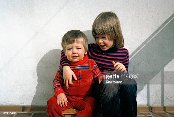 Two children sitting together