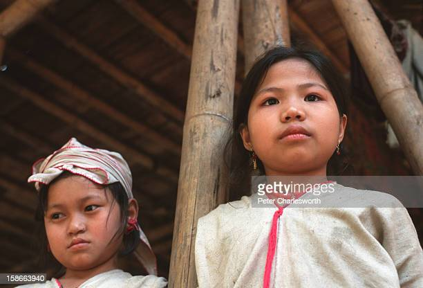 Two children stand near their wood and bamboo hut in a new Karen refugee camp north of the Thai town, Mae Sot. They are recent refugee arrivals to...