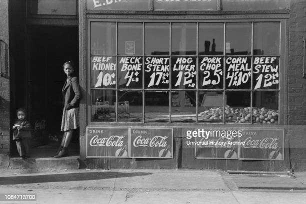 Two Children Standing in Doorway of Grocery Store, South Side, Chicago, Illinois, USA, Russell Lee, Farm Security Administration, April 1941.