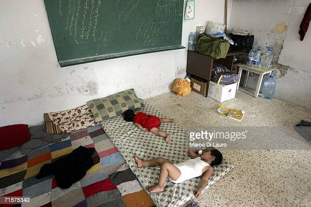 Two children staying in a school sleep on mattresses on the floor August 3 2006 in Tyre Lebanon Israel has sent thousands of troops to establish a...