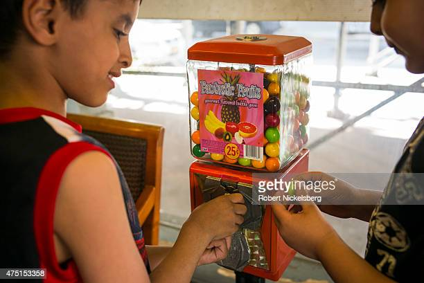 Two children use a coin operated gum ball machine in the Brooklyn borough of New York