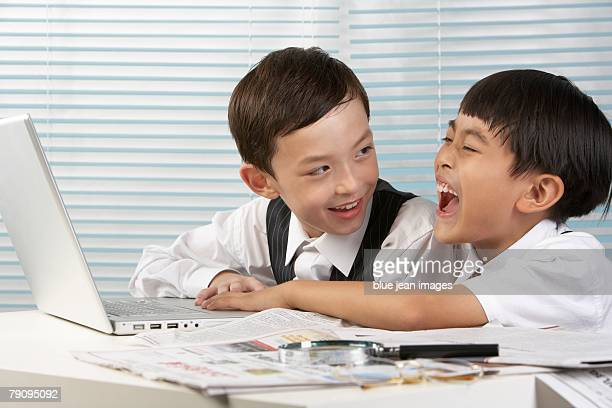 Two children using computer.