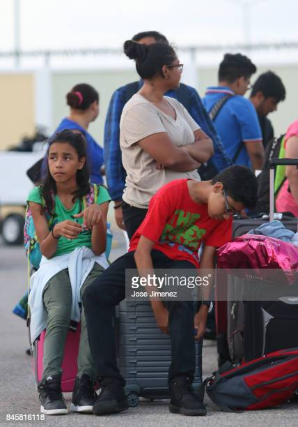Two children wait to be evacuated at Princess Juliana Airport on September 11 2017 in Philipsburg St Maarten The Caribbean island sustained extensive...