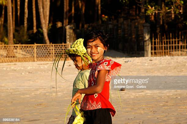 Two children walk the Ngapali beach with Thanaka on their faces Thanaka is a bark paste that locals use for protection from the sun and a clear...