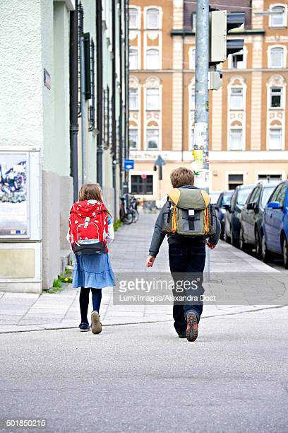 Two children walking to school, Munich, Bavaria, Germany
