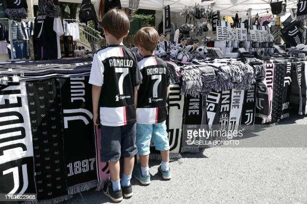 Two children wear a tshirt of Juventus' Portuguese forward Cristiano Ronaldo ahead of a friendly football match between Juventus A and Juventus B in...