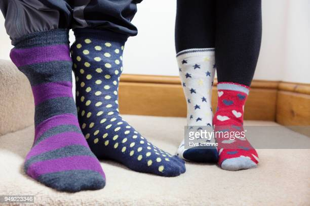 two children wearing odd socks - sock stock pictures, royalty-free photos & images