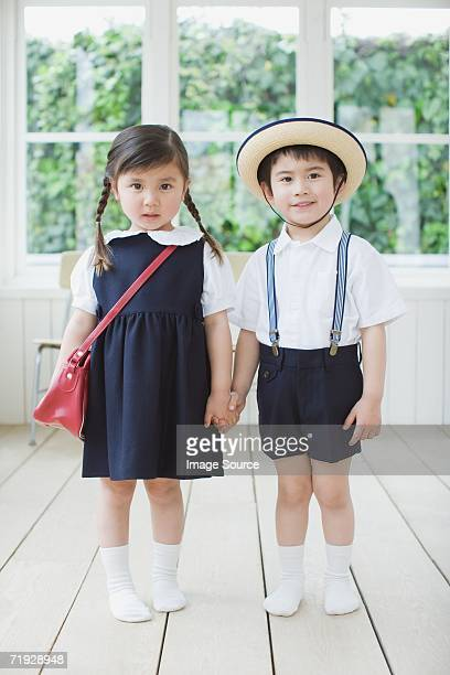 Two children wearing school uniform
