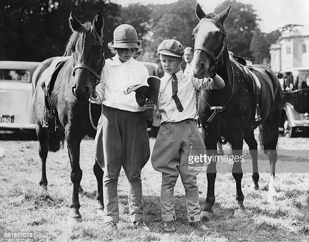 Two children with their riding horses at the Bucks County Show at Hartwell House 5th September 1935 Photograph