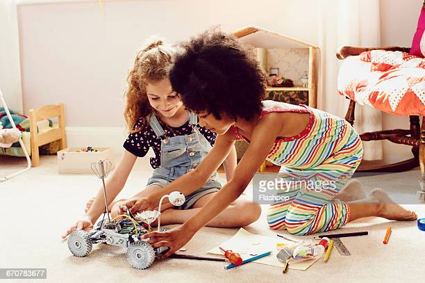 two children working together to make things - kneeling stock pictures, royalty-free photos & images