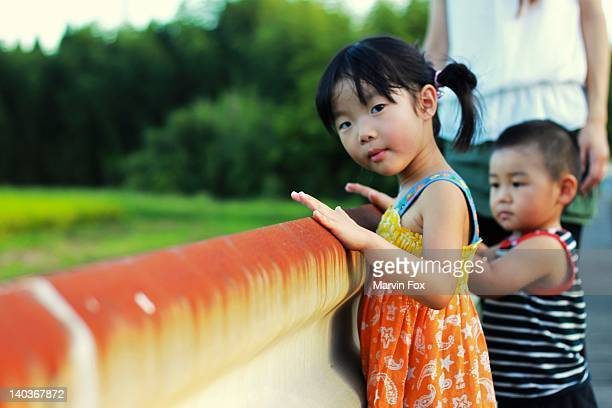 two childrens with mother in park - yonago stock photos and pictures